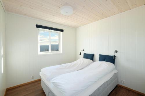 En eller flere senger på et rom på Voss Resort Bavallstunet