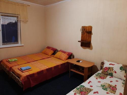 A bed or beds in a room at Jasmin Guest-House