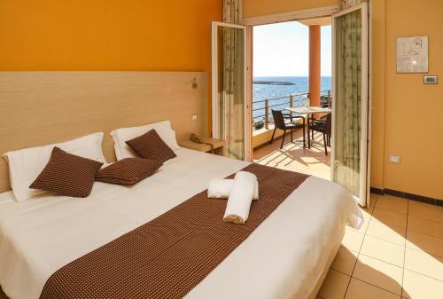 Кровать или кровати в номере Janus Hotel