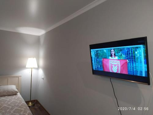 A television and/or entertainment center at Apartment on Kommunistichesky