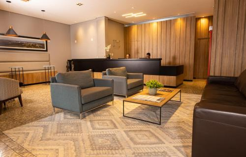 A seating area at BM Hotel