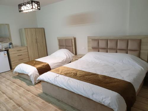 A bed or beds in a room at atoom studio