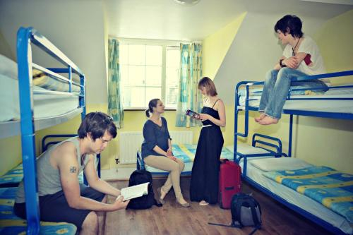 A bunk bed or bunk beds in a room at Neptune's Hostel