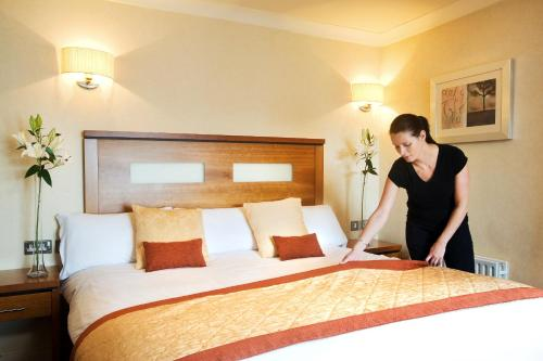 A bed or beds in a room at Tara Hotel