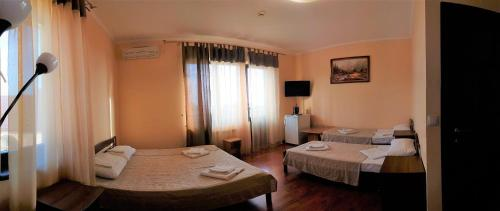 A bed or beds in a room at Mini Hotel Laza