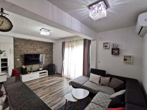 A seating area at Apartment Baćo