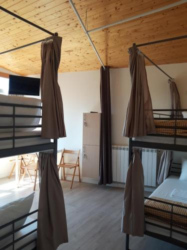 A bunk bed or bunk beds in a room at O Cabalo Verde