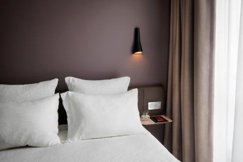 מיטה או מיטות בחדר ב-Okko Hotels Nantes Château