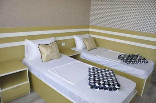 A bed or beds in a room at Grand Eliza