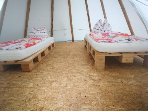 A bed or beds in a room at Youth Hostel Proteus Postojna