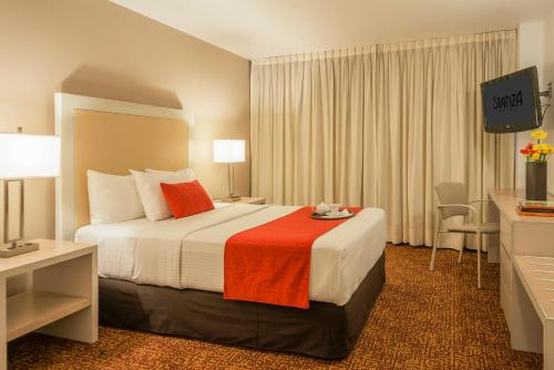 A bed or beds in a room at Stanza Hotel