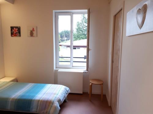 Un ou plusieurs lits dans un hébergement de l'établissement Centre Familial de Vacances Les Sylvageois