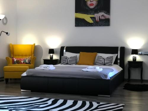 A bed or beds in a room at 9 Central Residence