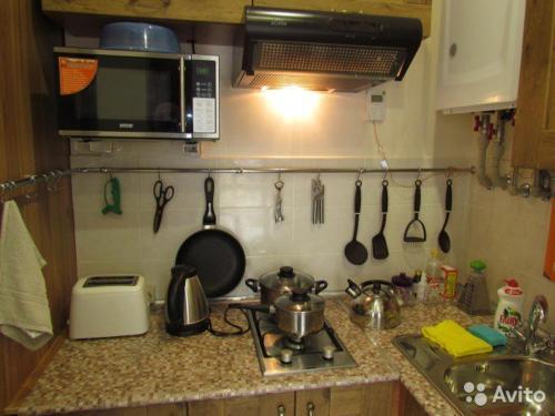 Кухня или мини-кухня в Apartment on Prosveshcheniya 148