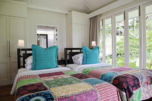Ein Bett oder Betten in einem Zimmer der Unterkunft Shantaa Koh Kood