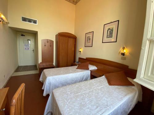 Кровать или кровати в номере Hotel Italia
