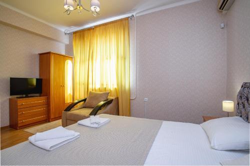 Кровать или кровати в номере Зеленый Дом в Мисхоре