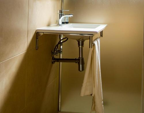A bathroom at Aparthotel Villas La Manga