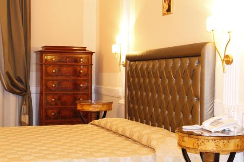 A bed or beds in a room at Boutique Hotel Trevi