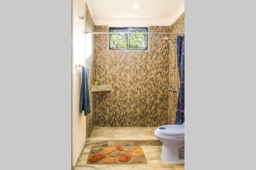 A bathroom at Ocean Breeze House - Modern Villa W/Pool Sleeps 4