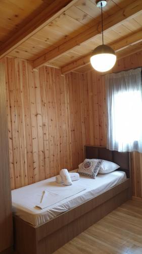 Ένα ή περισσότερα κρεβάτια σε δωμάτιο στο Villa Irida