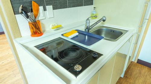 A kitchen or kitchenette at Shall Story Resort
