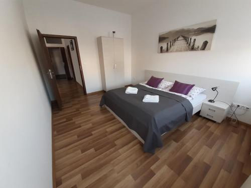 Łóżko lub łóżka w pokoju w obiekcie Apartmány MODOM