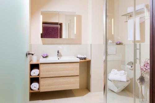 Ein Badezimmer in der Unterkunft Hotel Amaris