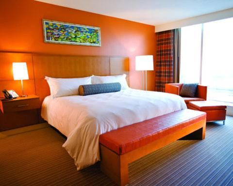 A bed or beds in a room at Greektown Casino-Hotel
