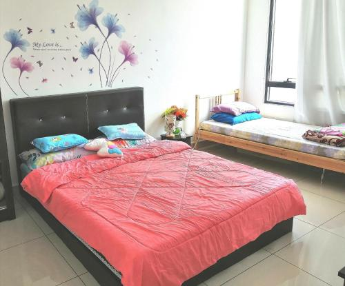 A bed or beds in a room at Woodsbury Butterworth Homestay Penang Sentral