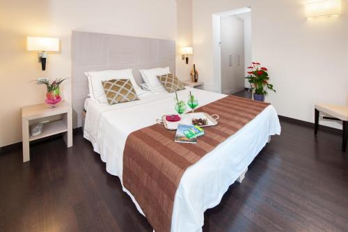 Кровать или кровати в номере Villa Maria Cristina
