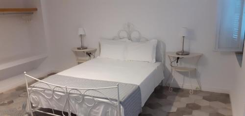 A bed or beds in a room at Filenia