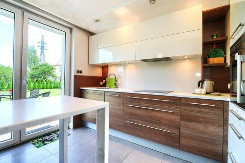 A kitchen or kitchenette at Happiness House Balcony & Nice Garden