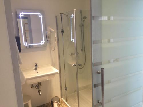 Ein Badezimmer in der Unterkunft Landhotel Gafringwirt