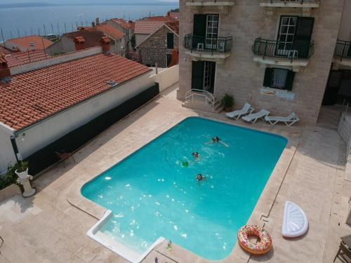 A view of the pool at Hotel Ivan or nearby