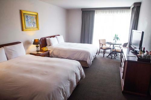 Cama o camas de una habitación en BTH Hotel Lima Golf