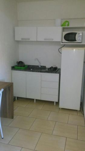 A kitchen or kitchenette at Hotel Passarela