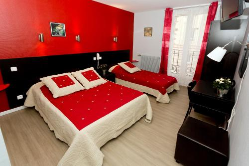 A bed or beds in a room at Hipotel Paris buttes chaumont Belleville