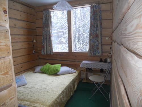 A bed or beds in a room at Guest House Kalbakas