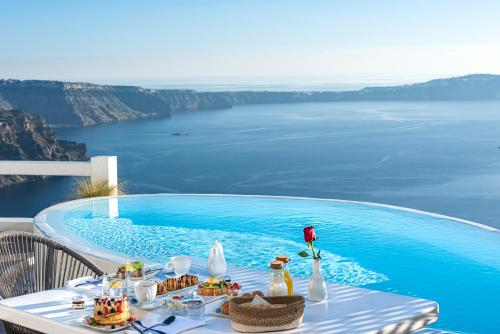 The swimming pool at or near Aqua Luxury Suites Santorini