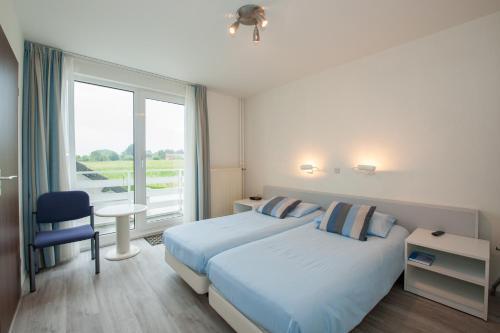 Een bed of bedden in een kamer bij Hotel Eperhof