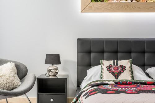 A bed or beds in a room at Apartamenty Comfort & Spa Stara Polana