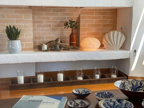 A kitchen or kitchenette at Niriedes Hotel