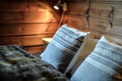 Ein Bett oder Betten in einem Zimmer der Unterkunft Fidjeland 61