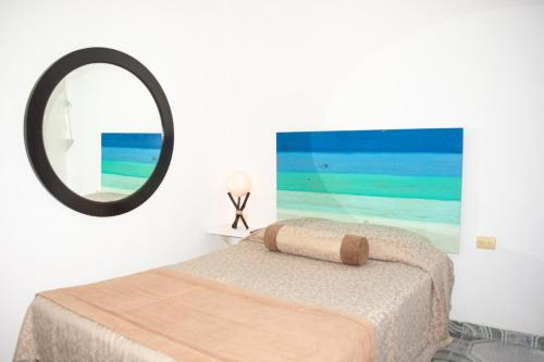 A bed or beds in a room at Hotel Nicte Ha Tulum