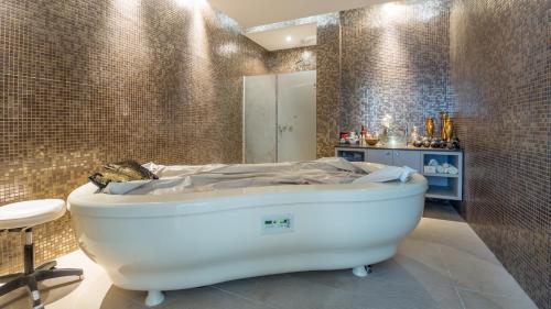 A bathroom at Vrissaki Beach Hotel