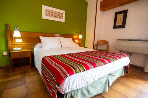 A bed or beds in a room at Hotel Rey Don Jaime