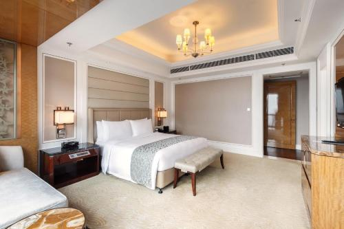 A bed or beds in a room at The Ritz-Carlton, Chengdu