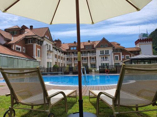 The swimming pool at or near Gran Hotel Balneario De Puente Viesgo