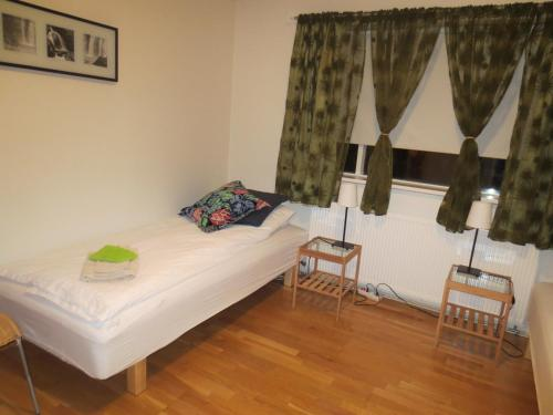 A bed or beds in a room at Teigur Guesthouse